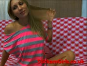 Sexy BLONDEFOXXY does a strip for her viewers